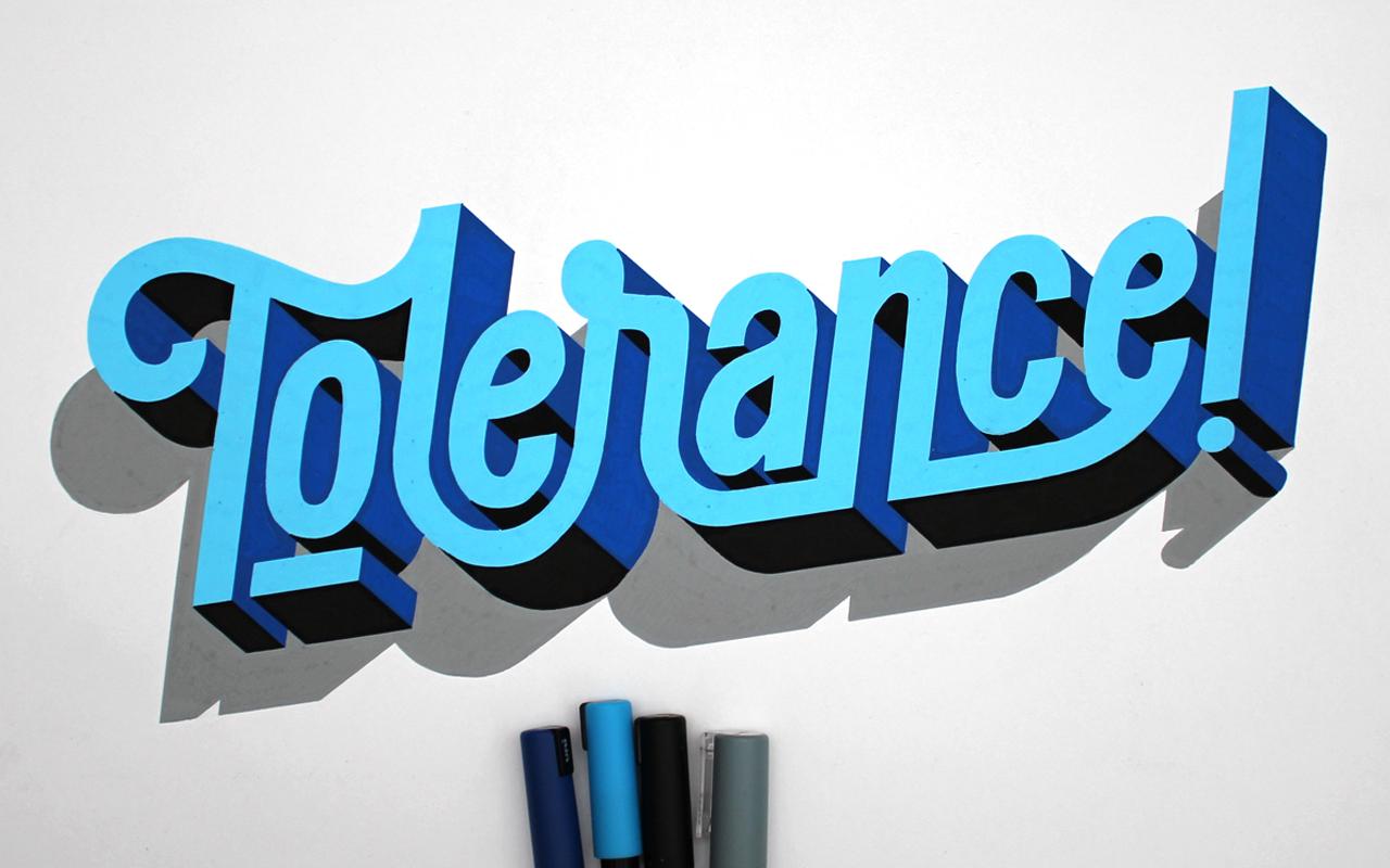 <span>TOLERANCE</span><i>→</i>